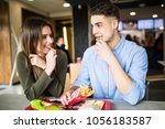 couple in a restaurant or diner ... | Shutterstock . vector #1056183587