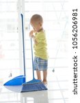 young child doing house chores... | Shutterstock . vector #1056206981
