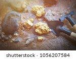 pure gold ore in mineral ore.... | Shutterstock . vector #1056207584