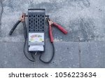 analog battery tester | Shutterstock . vector #1056223634