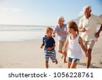 grandparents running along... | Shutterstock . vector #1056228761