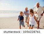 grandparents running along... | Shutterstock . vector #1056228761