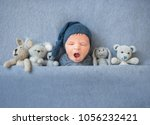 newborn baby boy yawning and... | Shutterstock . vector #1056232421