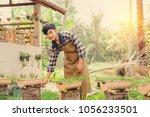 handsome man he is a farmer...   Shutterstock . vector #1056233501