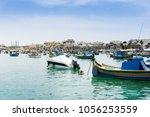 typical seaside port in...   Shutterstock . vector #1056253559
