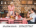 happy retro styled family... | Shutterstock . vector #1056257567