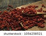 goji berries useful fruit...   Shutterstock . vector #1056258521