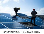 installing a solar cell on a... | Shutterstock . vector #1056264089