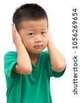 asian child covering his ears... | Shutterstock . vector #1056269654