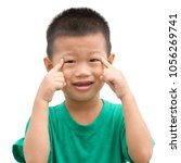 happy asian child pointing his... | Shutterstock . vector #1056269741