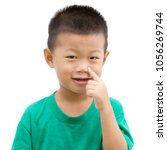 happy asian child pointing his... | Shutterstock . vector #1056269744