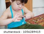 little girl cutting fingernails ... | Shutterstock . vector #1056289415