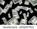 Small photo of Flying 100 American dollars banknotes, isolated on black background