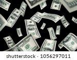 flying 100 american dollars... | Shutterstock . vector #1056297011