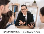representative realtor helps... | Shutterstock . vector #1056297731