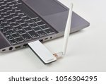 silver laptop with usb modem... | Shutterstock . vector #1056304295