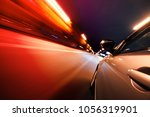 car on the road with motion... | Shutterstock . vector #1056319901