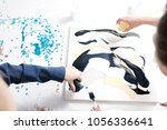 female artist painting acrylic... | Shutterstock . vector #1056336641