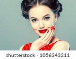 vintage pin up woman portrait.... | Shutterstock . vector #1056343211