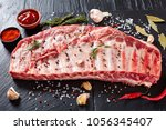 rack of raw pork spare ribs... | Shutterstock . vector #1056345407