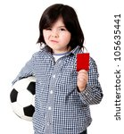 Boy playing football with holding a red card - isolated over - stock photo