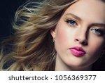 blonde long hair woman face... | Shutterstock . vector #1056369377