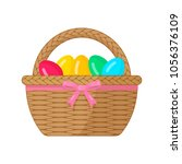 easter basket with painted eggs ... | Shutterstock .eps vector #1056376109