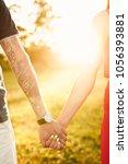 sunset in heart hands | Shutterstock . vector #1056393881