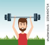man weight lifting in the field   Shutterstock .eps vector #1056404714