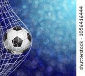 soccer ball in a grid   Shutterstock .eps vector #1056416444