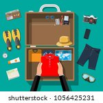 hands packs bag before... | Shutterstock .eps vector #1056425231