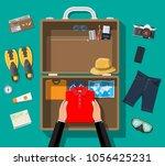 hands packs bag before... | Shutterstock .eps vector #1056425231