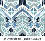 Ikat geometric folklore ornament. Tribal ethnic vector texture. Seamless striped  pattern in Aztec style. Figure tribal  embroidery. Indian, Scandinavian, Gypsy, Mexican, folk pattern.  | Shutterstock vector #1056426605