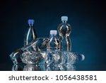 plastic bottle on the blue... | Shutterstock . vector #1056438581