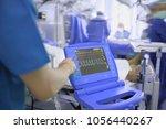 medical doctor adjusting ecg... | Shutterstock . vector #1056440267