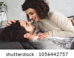 young couple lying on sofa and... | Shutterstock . vector #1056442757
