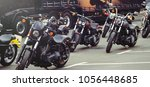 motorcycles stand in the...