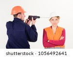 woman with bored face in helmet ... | Shutterstock . vector #1056492641