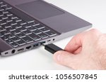 silver laptop and male hand... | Shutterstock . vector #1056507845