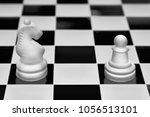 Small photo of Chess game pieces. The knight and pawn against each other. Concept of opposition and confrontation.