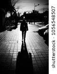 woman shadow at street | Shutterstock . vector #1056548507