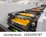 flexographic printing machine... | Shutterstock . vector #1056550787