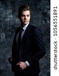 handsome young man in elegant... | Shutterstock . vector #1056551891