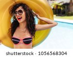 beautiful woman in bikini...   Shutterstock . vector #1056568304