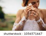 beautiful bride in white dress...   Shutterstock . vector #1056571667