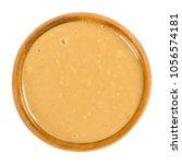 crunchy peanut butter in wooden ... | Shutterstock . vector #1056574181