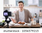 young food blogger recording... | Shutterstock . vector #1056579215