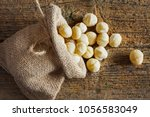 macadamia nuts in small sack on ... | Shutterstock . vector #1056583049