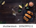 cooked salmon with white wine... | Shutterstock . vector #1056599111