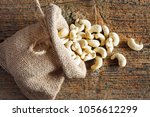 cashew nuts in small sack on... | Shutterstock . vector #1056612299
